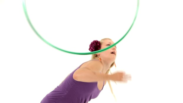 Q. How to Do a Hula Hoop Tuck Toss Promo Image