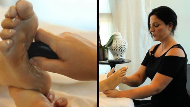Q. How to Place Hot Stones for a Foot Massage Promo Image