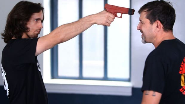 U. How to Defend Yourself against a Gun to the Face in Krav Maga Promo Image