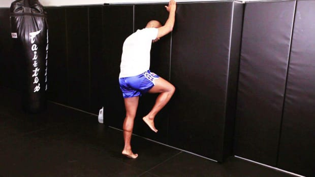 L. How to Practice a Knee Attack Using a Wall in Muay Thai Promo Image