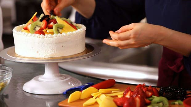 W. How to Decorate a Cake with Fruit Promo Image