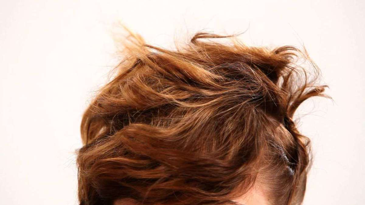 How To Pin Hair For A Messy Updo Howcast The Best How To Videos